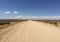 UltimateGraveyard Mojave Desert Main Road Leading from Property - Facing North