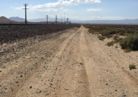 UltimateGraveyard Mojave Desert Dirt Road Parallel to Train Tracks